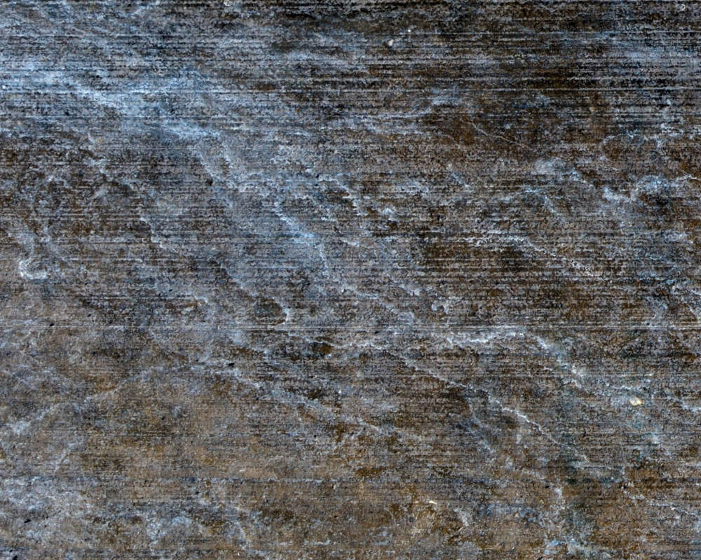 Blue fine art abstract image of water stains in concrete sidewalk.