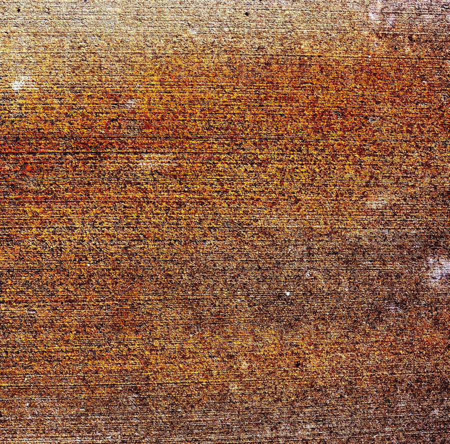 Fine art abstract image of rust and water stains in concrete sidewalk.
